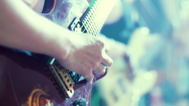CU : Man Playing A Guitar At A Rock Concert video