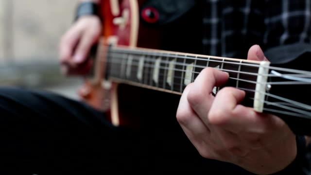 Man playing a guitar video