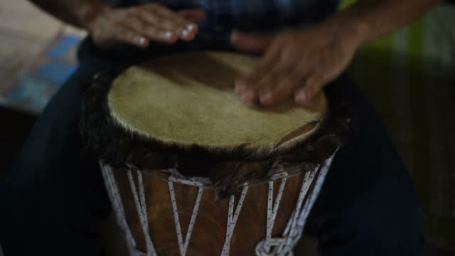 Man playing a wooden drum. video