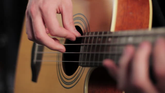 Man playing acoustic bass in studio, shallow depth of field video