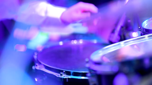 Man playing drums during rock concert video