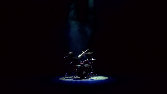 Man playing drums on black background with smoke. video