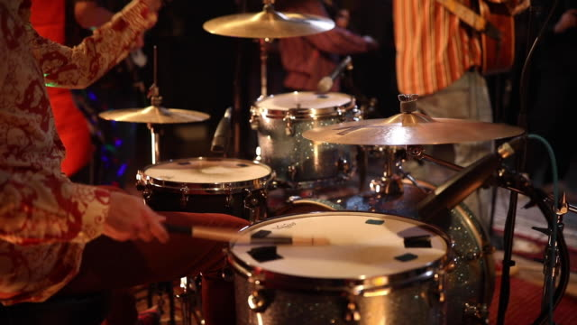 Man playing drums on rehearsal with his band