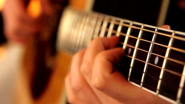 man playing guitar close up - akustisk gitarr bildbanksvideor och videomaterial från bakom kulisserna