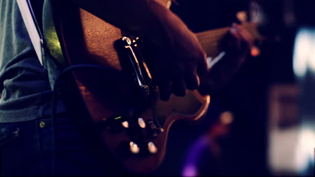Video Man playing guitar close up