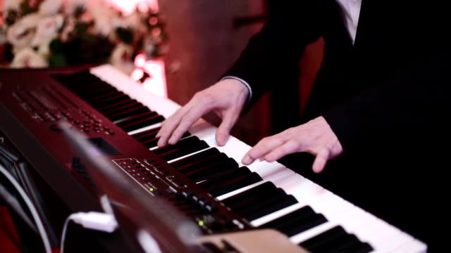 man playing on a synthesizer - classical architecture stock videos & royalty-free footage