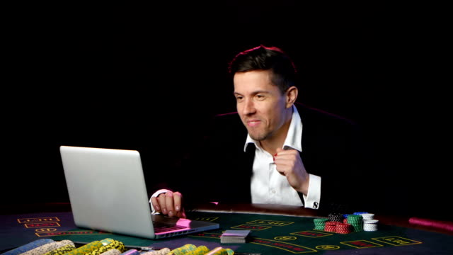 Man playing poker online and loses. Close up video