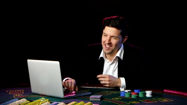 Man playing poker online and losing. Close up video