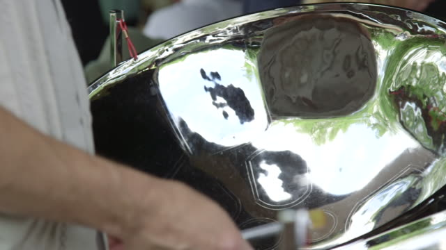 Man Playing Steel Drums Instrument At Event