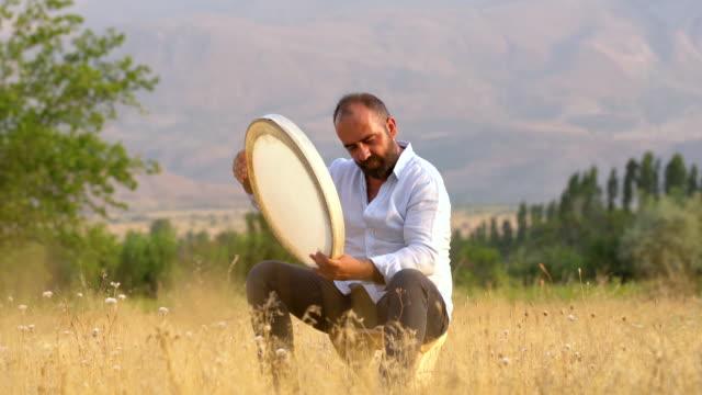man playing tambourine - cultura turca video stock e b–roll