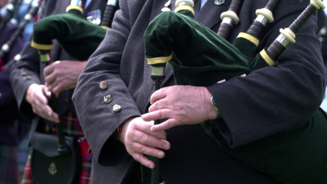 Man playing the Bagpipes (Scotland Piper) Stock 4K video clip footage of a Scotsman playing the Scottish bagpipes - Piper - Close up shot scotland stock videos & royalty-free footage