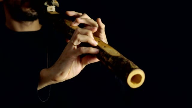 man playing the flute