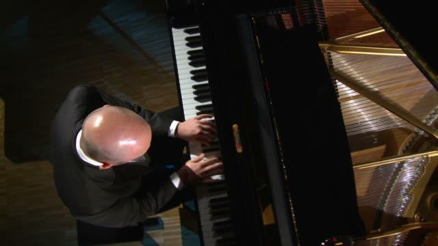 HD CRANE: Man Playing The Grand Piano video