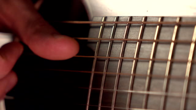 Man playing the guitar. Trembling strings. Super slow motion macro video video