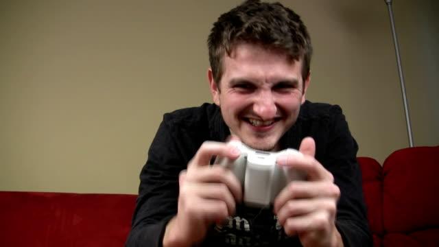 vídeos de stock e filmes b-roll de homem jogando jogos de vídeo - man joystick