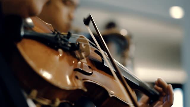 Man playing violin at a concert video