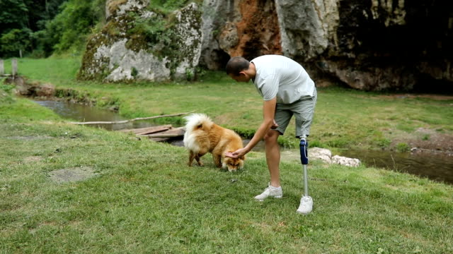 Man playing with pet