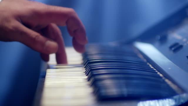 Man plays music keyboard. Musician play piano. Shot on RED EPIC Cinema Camera. video