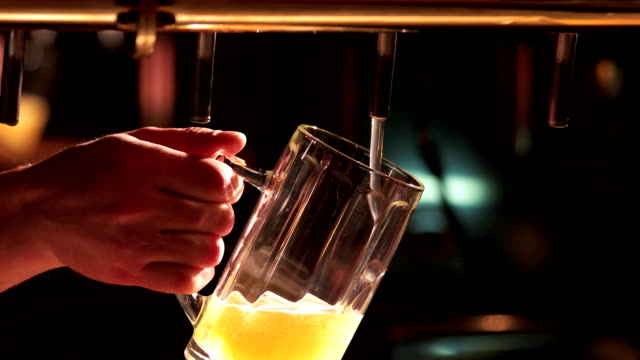 Man pours beer into a glass. video