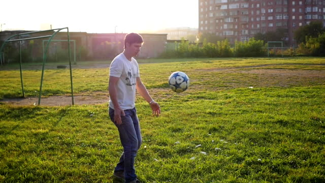 man practicing with a ball on the soccer field video