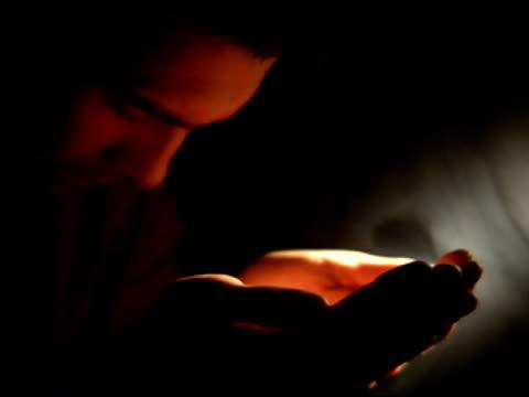NTSC - Man prays with ray of light video