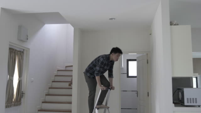 Man preparing and improving his own house video