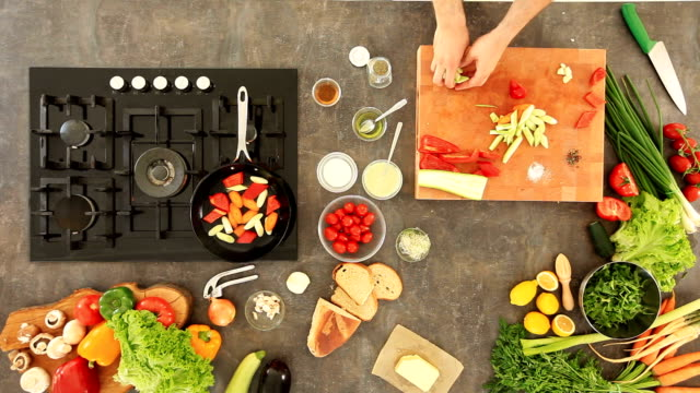 Man preparing grilled vegetables video