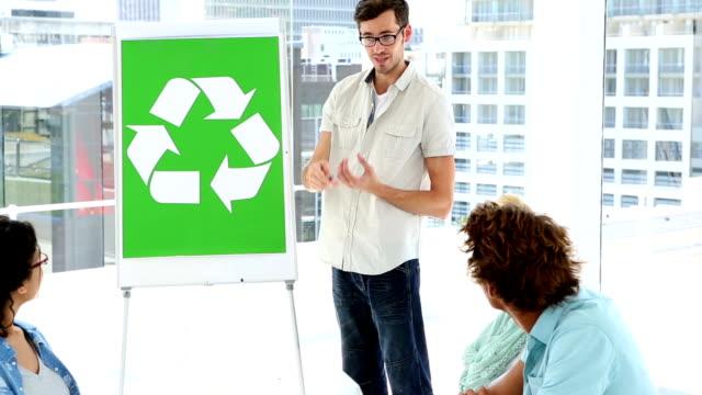 Man present environmental awareness plan to colleagues