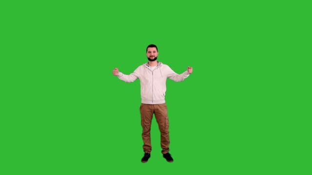 Man presenting copy space on green screen background Young man in casual clothes presenting copy space with thumb up sign isolated on green screen background with alpha channel. one person full length stock videos & royalty-free footage