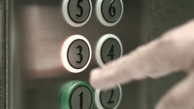 Man presses a button the third floor in an elevator video