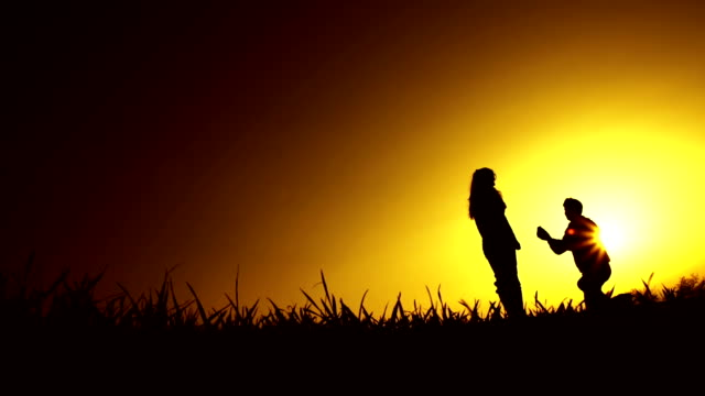 Man Proposing Engagement Silhouette Sunset Marriage Concept video