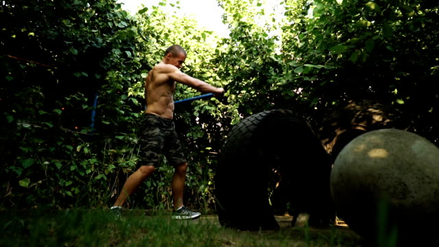 Man punching the truck tire video