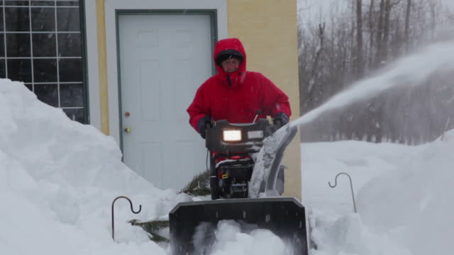 Man pushing snow blower video
