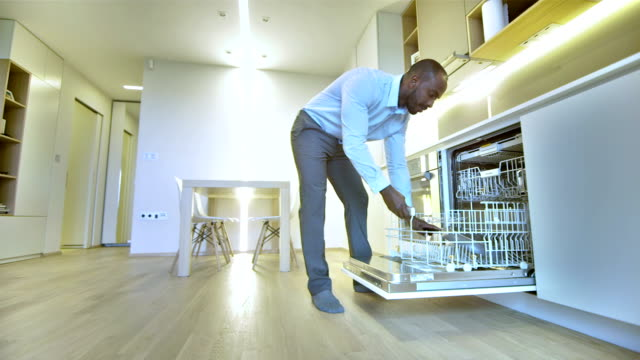 LS Man Putting Dishes Into A Dishwasher video