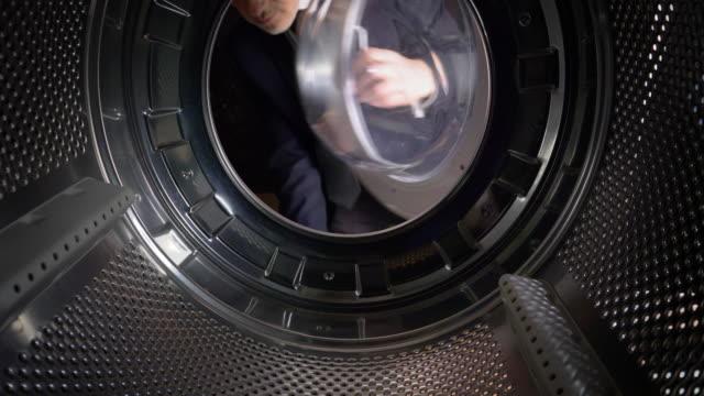 POV Man putting Euros into a washing machine video