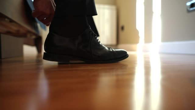Man putting on the black ,leather, formal shoes video