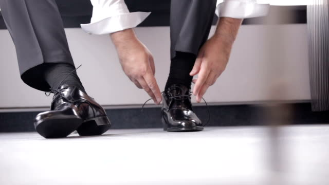 Man putting shoes video