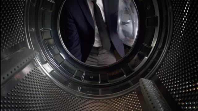 POV Man putting UK pounds into a washing machine video