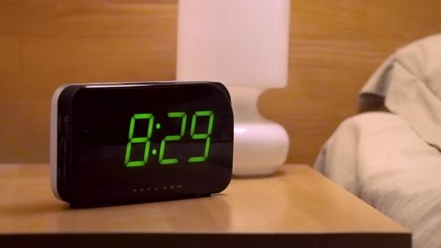 stockvideo's en b-roll-footage met man het bereiken van het uitschakelen van digitale wekker in de ochtend om 8,30 uur - alarm, home,