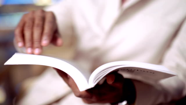 Man reading. Book in his hands. Man reading. Book in his hands. handbook stock videos & royalty-free footage