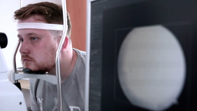 Man ready for checking his eye retina. Security guard scanning eye for access to restricted area video
