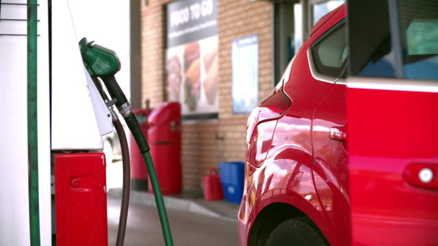 Man refuelling a car at a petrol station video