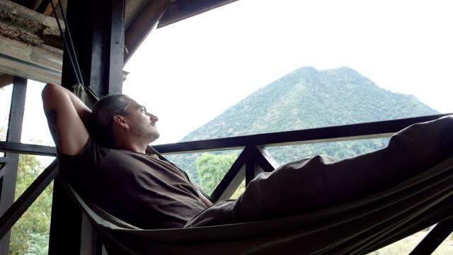 man relax in a hammock - amaca video stock e b–roll