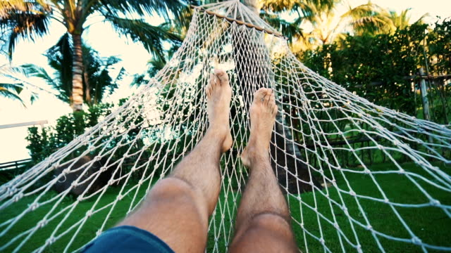 man relaxing on the hammock - garden party stock videos and b-roll footage