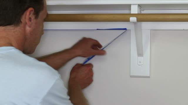 Man Removing Painter's Tape video