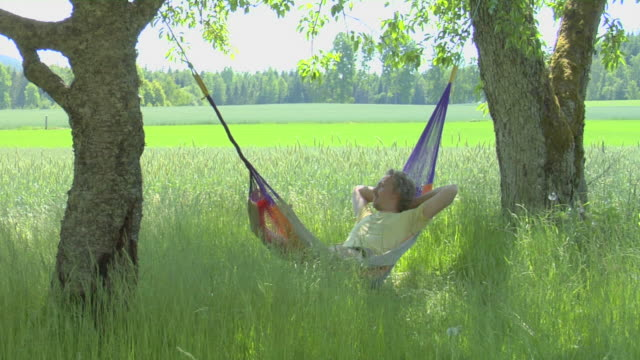 Man resting in Hammock, Peace of mind video