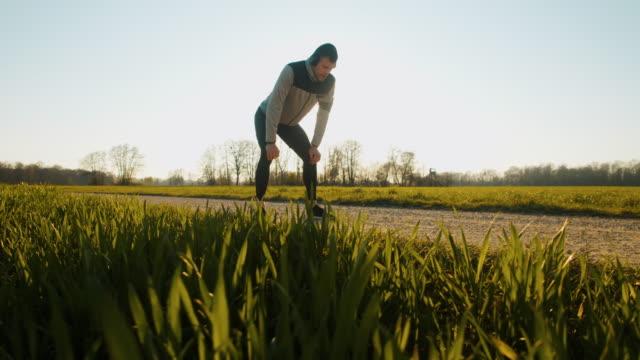 SLO MO WS POV Man resting while jogging