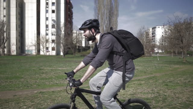 Man Riding a Bicycle on Nature Background video