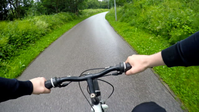 Man riding a bicycle. Point of view shot. Man riding a bicycle. Point of view shot. handlebar stock videos & royalty-free footage