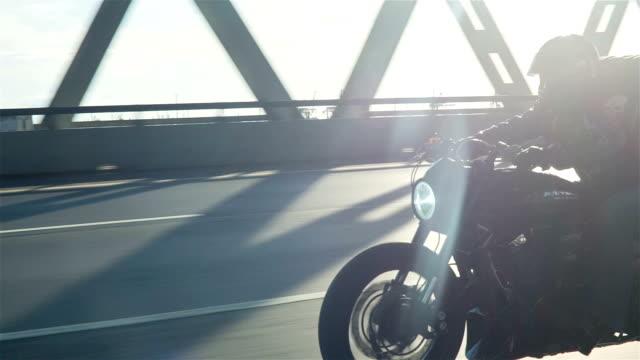 Man Riding Motorcycle In Asphalt Road video